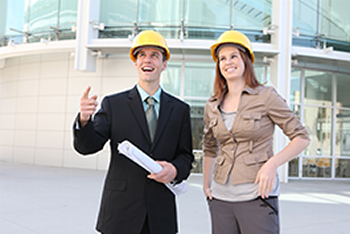 Man and Woman in hardhats